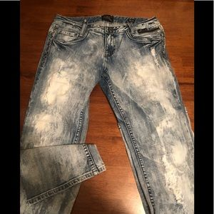 Heavily distressed Express Rerock Jeans. Boot